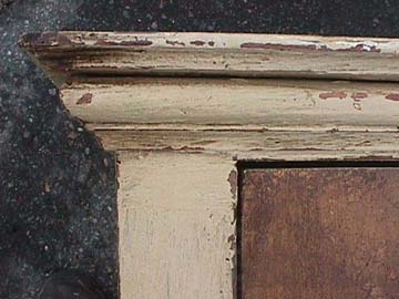entertainment center moulding painted and worn to look old